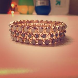 Gold and jeweled bracelet